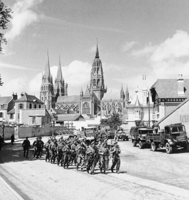 British Troops March Through Freed Bayeux